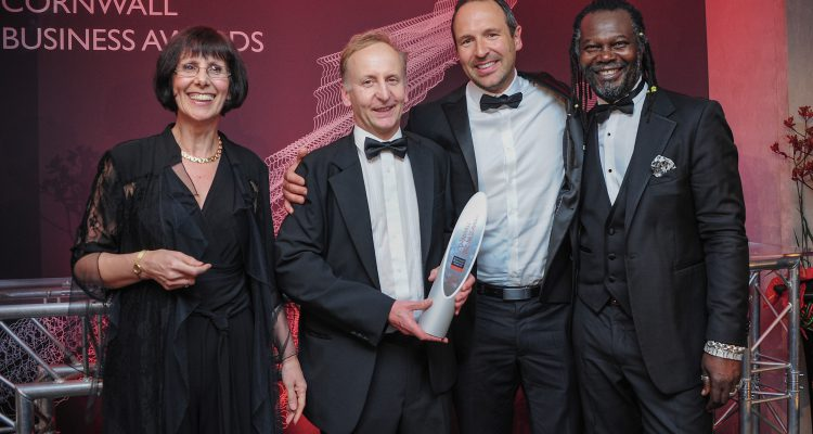Cornwall Innovation receiving their award from special guest host at the Cornwall Business Awards, Reggae Reggae Sauce entrepreneur Levi Roots