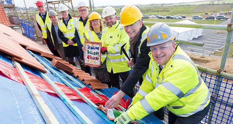 Skol Nansledan topping out. DCA supported clients Midas Group, Duchy of Cornwall and Aspire Academy Trust.